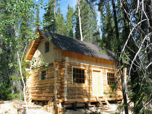 Yukon log cabin rental lakefront otter island for Big island cabins